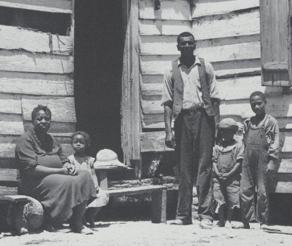 The Brown family in front of their home, c. 1939