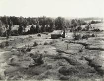 Farm House on Eroded Land
